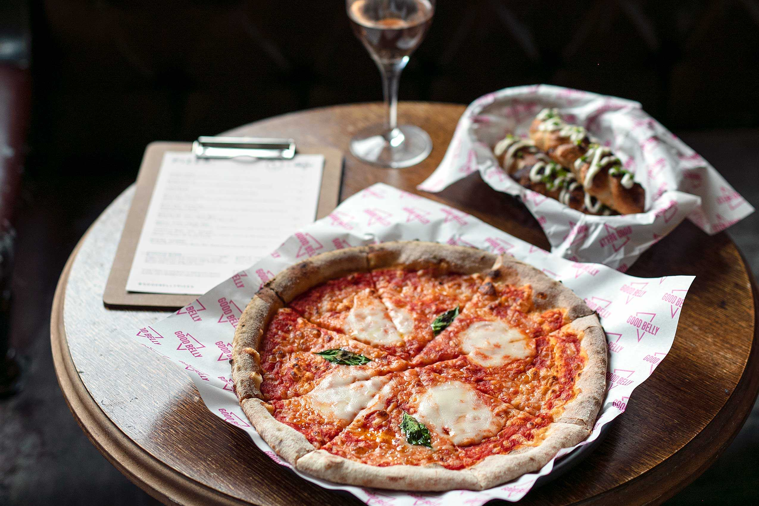Photograph of Pizza and wine in the Railway Tavern Pub Dalston
